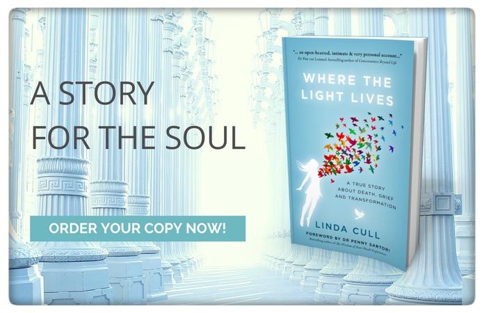Book Where The Light Lives set against heavenly pillars