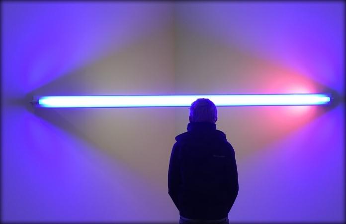 man looking at white light