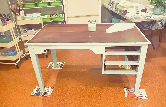 Art table partially painted with chalk paint