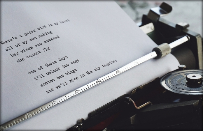 vintage typewriter with sheet of poetry